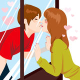 Kissing Through Window Royalty Free Stock Photography
