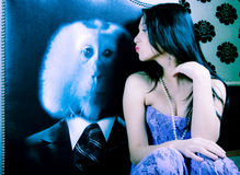 Kissing Woman. A portrait of a glamorous young woman kissing a poster of a monkey Royalty Free Stock Image