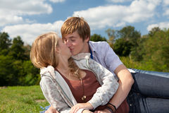 Kissing young couple Stock Photography