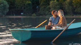 Kissing young couple on vacation. Kissing young couple in a boat on vacation Royalty Free Stock Photography