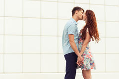 Kissing young couple Stock Photos