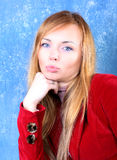 Kissing young woman portrait. In red. Studio shot Royalty Free Stock Photos