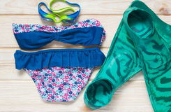 Kit for children in the summer sea. Goggles and a swimsuit on the table Royalty Free Stock Images