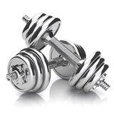 Kit of chromed sports dumbbells Royalty Free Stock Photos