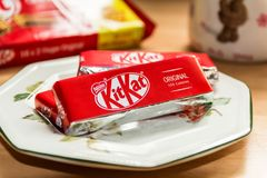 Kit Kats on a Side Plate with Coffee to the side Royalty Free Stock Photography