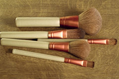 Kit of makeup brushes over a wood background Stock Photo