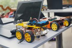Kit models and laptops on the table on robotics. Education Stock Photography