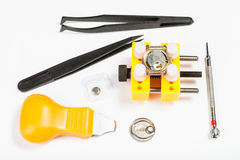 Kit for replacing battery in watch. Watchmaker workshop - kit for replacing battery in watch on white background Stock Image