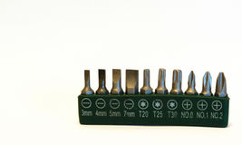 Kit of 10 screw bits isolated with green housing Stock Images
