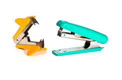 Kit of stapler, staple remover. On white background Royalty Free Stock Images