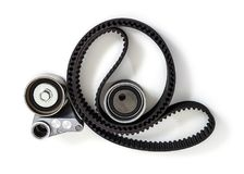 Kit of timing belt with rollers on a white background isolated. royalty free stock photos