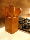 Kitchen. Wooden forks and spoons on kitchen light table stock photos