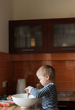 Kitchen. Boy helping his mother in the kitchen Royalty Free Stock Photos