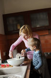 Kitchen. Child helping his mother in the kitchen Stock Photo