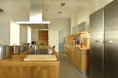 Kitchen. Modern kitchen with metallic details in apartment Royalty Free Stock Photos