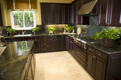 Kitchen 1748. Kitchen with granite top island and modern stove stock image
