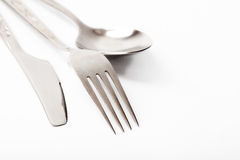 Kitchen. Knife, fork and spoon on a white background Royalty Free Stock Image