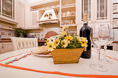 Kitchen. Interior of a table room in in classical style with a kind on kitchen Royalty Free Stock Images