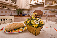 Kitchen. Interior of a table room in in classical style with a kind on kitchen Stock Photography