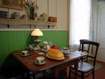 Kitchen from 19'th century. A kitchen with vintage furniture and porcelain set, table and chairs, photo taken in Rancho Santa Teresa, a historic farm house open Stock Photography