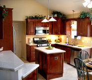 Kitchen 2. New kitchen with cherry cabinets Stock Image