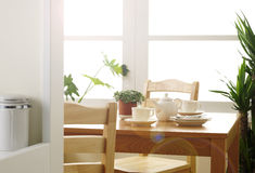 Kitchen. And dining room in morning Royalty Free Stock Photos