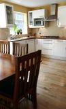 Kitchen. Modern white kitchen and dinning table Stock Photo
