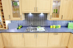 Kitchen. Fitted kitchen with sink and cupboards stock photos