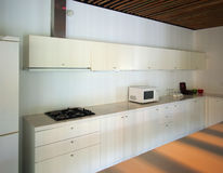 Kitchen. A modern kitchen in a new house Stock Photography