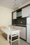 Kitchen. Brown and white kitchen interior stock photography