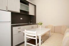 Kitchen. White and brown kitchen interior stock image