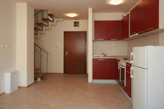 Kitchen. Red kitchen interior first floor Stock Photos