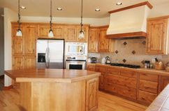Kitchen. A tidy pine kitchen in a Montana home Stock Photography