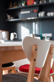 In a kitchen. Photo taken in natural light. Focus on a chair, in a background blurred kitchen Stock Images