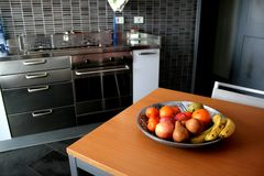 Kitchen. A modern kitchen and a fruit on the table Royalty Free Stock Images