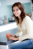 In The Kitchen. A young woman having juice in the kitchen stock photos