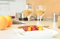 Kitchen. Two glasses of vine on modern kitchen Royalty Free Stock Images