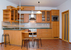 Kitchen. Beautiful modern kitchen and dining-room Royalty Free Stock Image