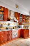 Kitchen. Traditional wooden kitchen furniture in domestic home royalty free stock photo