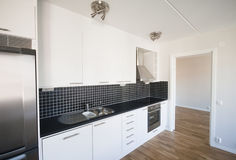 Kitchen. New kitchen in a new department royalty free stock photography