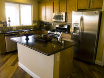 Kitchen. View of kitchen with granite table tops and steel appliances Royalty Free Stock Photography