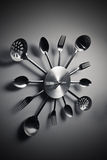 Kitchen abstract clock witch spoon and fork. Dramatic light used stock photo