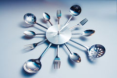 Kitchen abstract clock witch spoon and fork. Dramatic light used stock images