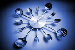 Kitchen abstract clock witch spoon and fork Royalty Free Stock Images