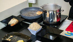 Kitchen accessories - pot, pan and black plates Royalty Free Stock Photography
