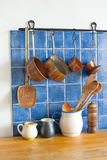 Kitchen accessories. pots jug pan wooden spoons, cooper ladle stewpan. wood table background Royalty Free Stock Photo