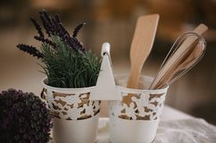 Kitchen accessories in the style of Provence. Devices for cooking from natural wood. Lavender in a pot. Background for food concep. T design or interior design stock photography