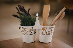 Kitchen accessories in the style of Provence. Devices for cooking from natural wood. Lavender in a pot. Background for food concep. T design or interior design stock image