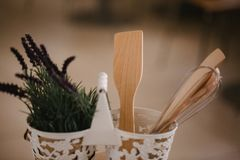 Kitchen accessories in the style of Provence. Devices for cooking from natural wood. Lavender in a pot. Background for food concep. T design or interior design stock photo