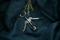 Kitchen accessory. Metal bottle opener with rosemary. Royalty Free Stock Images
